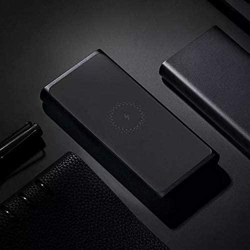 Batterie externe sans fil Xiaomi a cote de smartphones